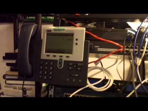 Cisco Network Rack With Switches, Routers And Phones.